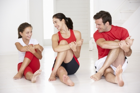 fits in: Mother,father and daughter doing yoga