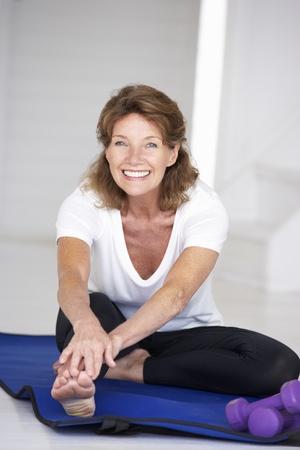 senior exercising: Senior woman exercising at home