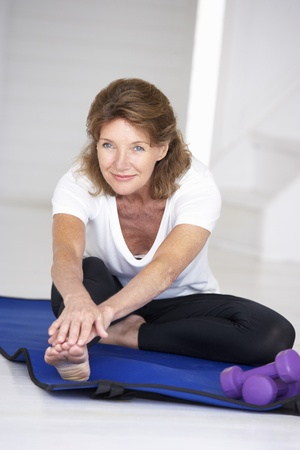 woman working out: Senior woman exercising at home