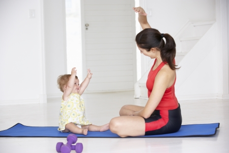 mums: Mother and baby doing yoga
