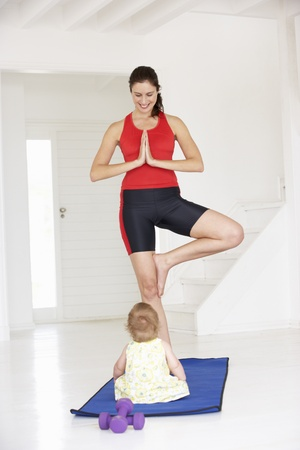 Mother and baby doing yoga photo