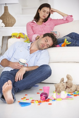 male parent: Exhausted parents resting Stock Photo