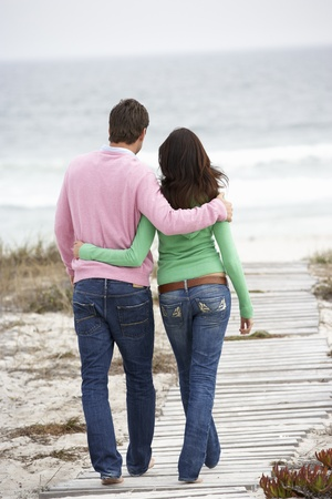 Couple walking by the sea photo