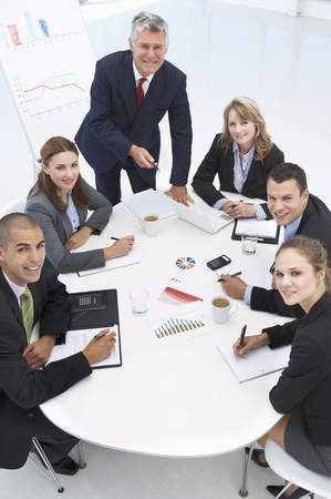 business woman phone: Mixed group in business meeting