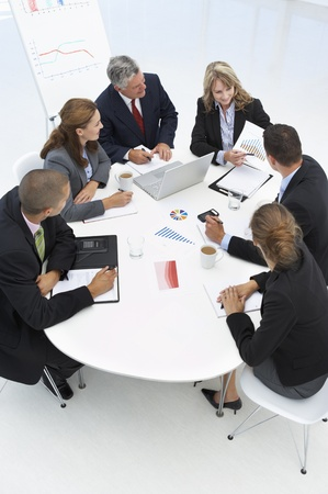Mixed group in business meeting photo