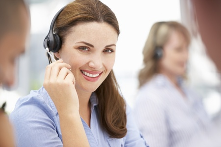 Businesswoman wearing headset photo