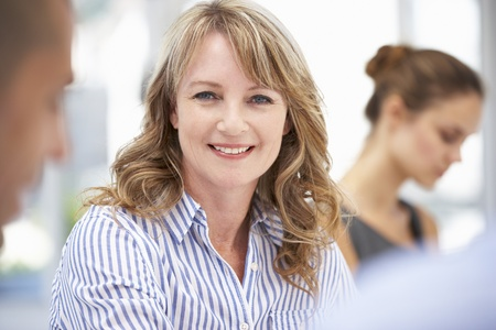 Mid age businesswoman in meeting Stock Photo - 11211119
