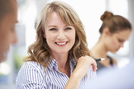 male age 40's: Mid age businesswoman in meeting