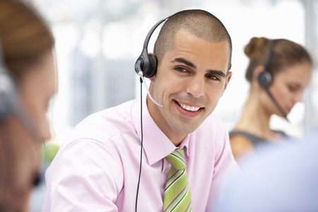 support center: Young businessman wearing headset