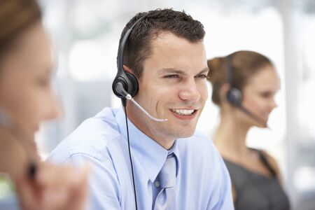 business center: Young businessman wearing headset
