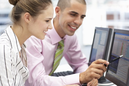 Businessman and woman working on computers Stock Photo - 11210940