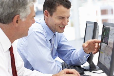 Businessmen working on computers Stock Photo - 11210942