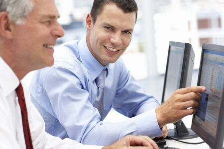 fmale: Businessmen working on computers Stock Photo