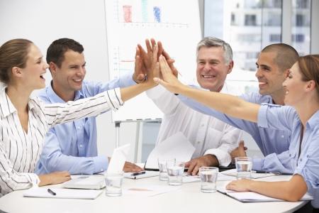 gente celebrando: Colegas en reuniones de negocios Foto de archivo