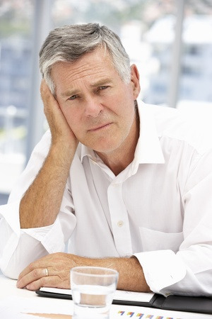 Unhappy senior businessman photo