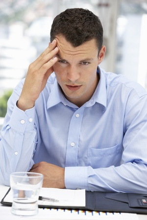 frowning: Thoughtful young businessman