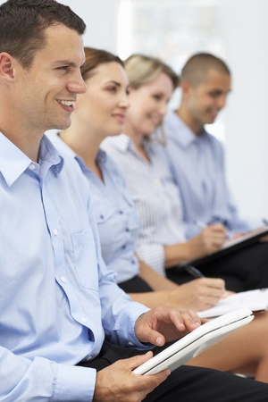 informal: Group watching business presentation