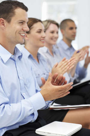 people clapping: Group applauding business presentation Stock Photo