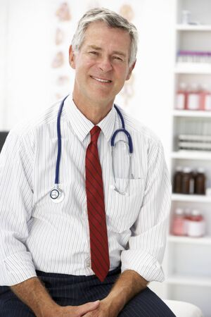 approachable: Senior doctor in consulting room Stock Photo