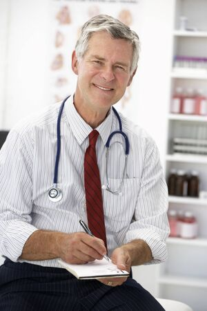approachable: Senior doctor writing prescription