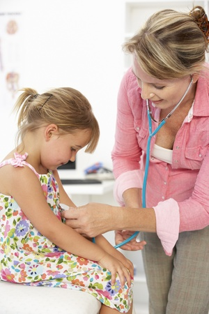 paediatrician: Female doctor examining child