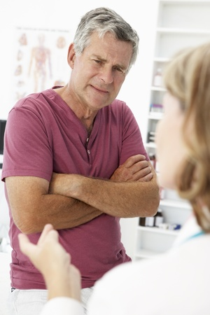 Senior man visiting doctor