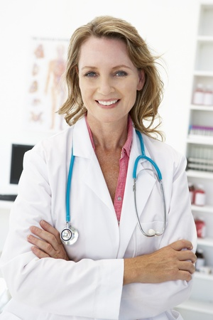 smiling doctor: Mid age female doctor Stock Photo
