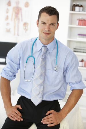 consulting room: Young male doctor in consulting room