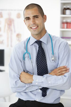 young male doctor: Young male doctor in consulting room