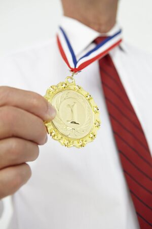 gold top: Businessman wearing medal Stock Photo