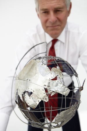 Senior businessman with globe photo