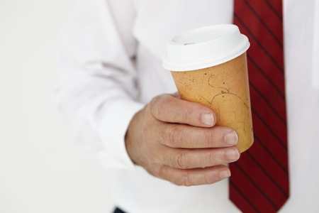 go inside: Businessman holding takeout coffee