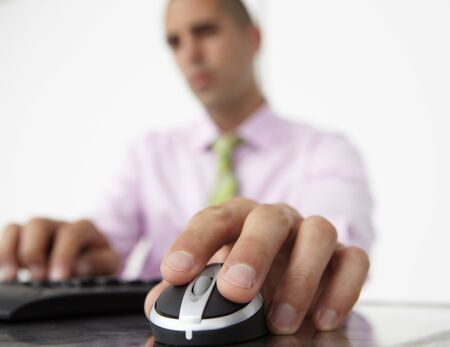 scrolling: Close up man using  keyboard and mouse Stock Photo
