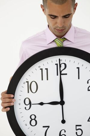 Young businessman with giant clock Stock Photo - 11211043
