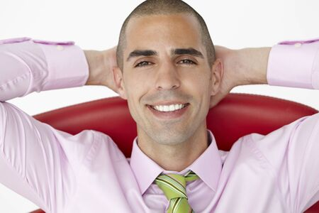 easy chair: Young businessman relaxing in chair Stock Photo