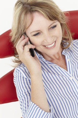 40s adult: Mid age businesswoman using cellphone