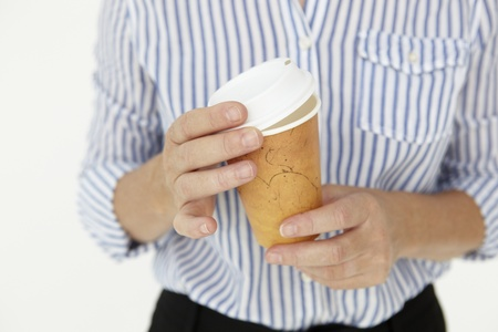 Businesswoman holding takeout coffee photo
