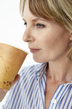 Businesswoman drinking takeout coffee Stock Photo - 11217446