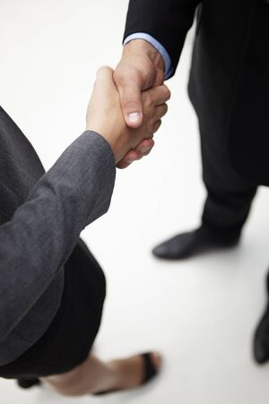 parting: Detail businessman and woman shaking hands Stock Photo