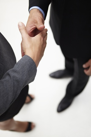 Detail businessman and woman shaking hands photo