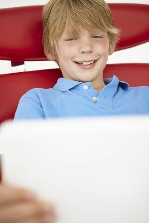 Young boy using laptop photo