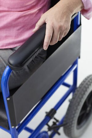 immobility: Detail of woman in wheelchair