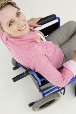 Mid age woman in wheelchair photo
