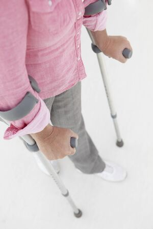 Woman walking with crutches photo