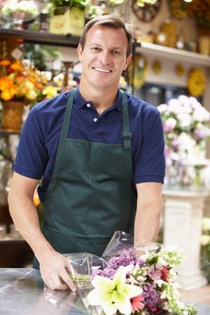 retailer: Man working in florist