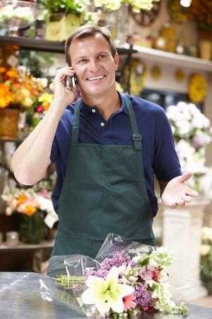 shop owner: Man working in florist