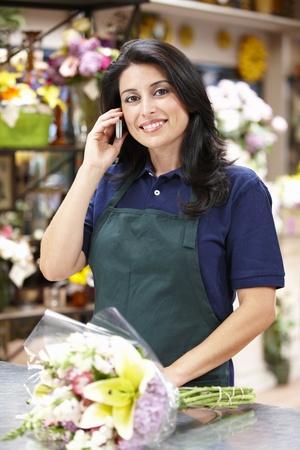 retailer: Hispanic woman working in florist