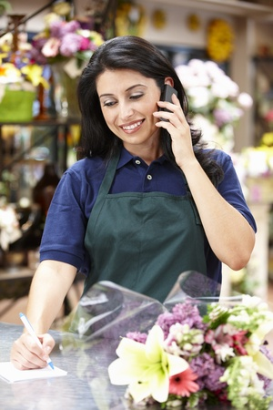florist shop: Hispanic woman working in florist