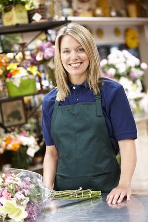 retailer: Woman working in florist
