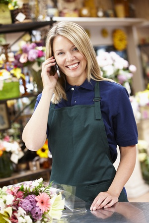 florist shop: Woman working in florist